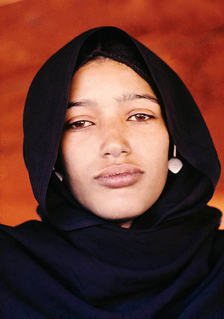 Niger. Sahel. Tuareg nomad sitting under her leather tent.